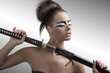 brunette in japan style with katana and closed eyes