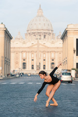 Young ballerina dancing in the street in front of St. Peter