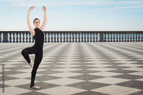 Portrait of young dancer outdoors in front of the sea.