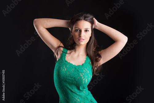 Beautiful brunette woman portrait on black background.