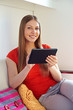 woman holding the tablet pc and smiling