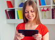 woman looking at tablet pc and smiling