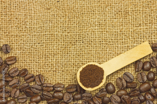 Coffee ground in spoon on coffee seeds