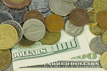 One hundred dollars under coins