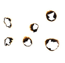 Collection of burnt holes in a piece of paper