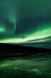 Northern lights above lagoon in Iceland