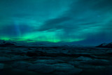 Fotoroleta Northern lights above lagoon in Iceland