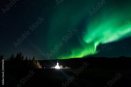 Northern lights above a church in Iceland