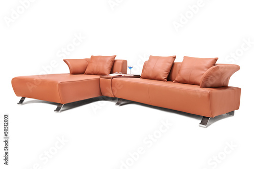 Studio shot of a luxury brown leather sofa