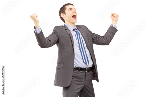 Young businessman gesturing excitement with raised hands