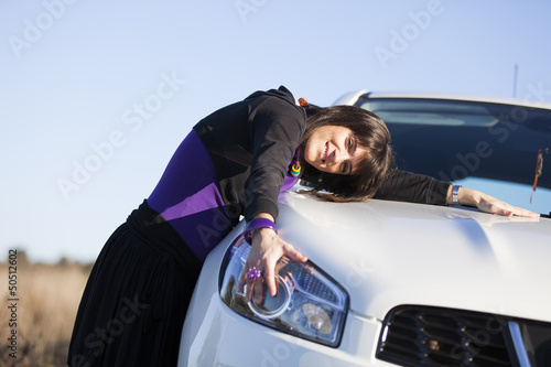 .Woman embracing her new car