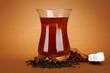 glasses of Turkish tea, on brown background