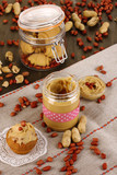 Delicious peanut butter in jar with baking