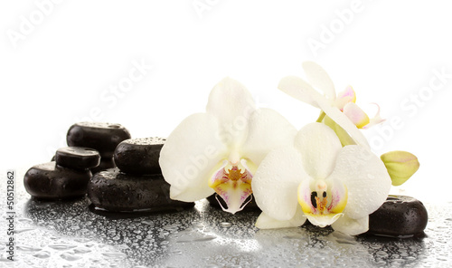 Fototapeta Spa stones and orchid flowers, isolated on white.