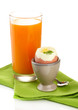 Light breakfast with boiled egg and glass of juice, isolated