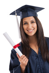 Beautiful graduate in cap and gown holding diploma