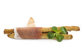 Italian prosciutto on a bread stick
