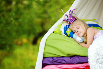 "the princess sleeps on a bed. fairy tale ""the princess on a pea"