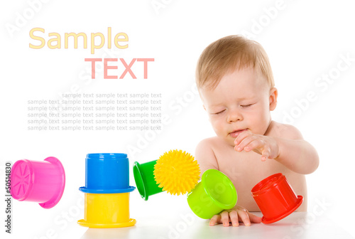 Child playing with educational cup toys. Isolated on white