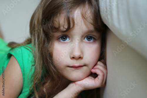 Portrait of a depressed little girl