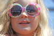 Cute little blonde girl wearing sunglasses