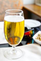 Corner bar table beer peanuts and shades
