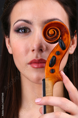 Beautiful young girl with violin close up