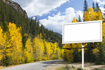 Blank Billboard Along Mountain Road in Fall