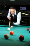 person playing snooker in a club