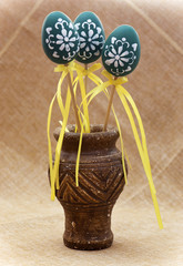 Three turquoise easter eggs in the vase