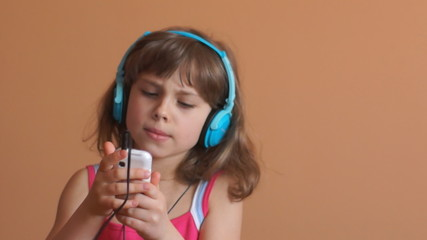 Pretty little girl with music player