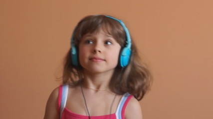 Pretty little girl with headphones