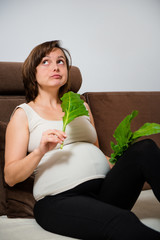 Pregnant woman eating spinach