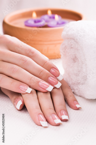 beautiful manicure with aromatic candles and towel. Spa