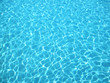 Clear blue water in swimming pool - 50521628