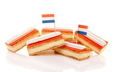 Pile of traditional Dutch pastry called tompouce with flags