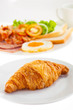 croissant and American Breakfast on white background
