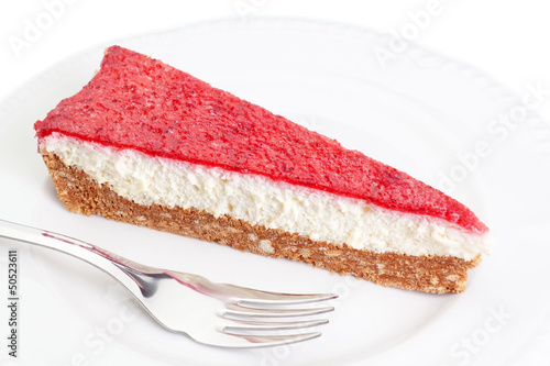 A piece of delicious cake with strawberries and cream on a plate
