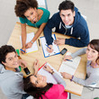 Leinwanddruck Bild - Happy Friends Studying Together