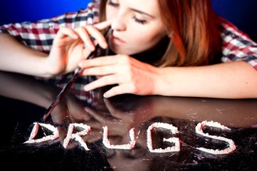 Girl with drug addiction snorting cocaine or amphetamines