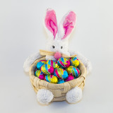 Easter bunny with chocolate egg waiting for Easter