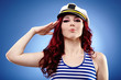 Cute female sailor saluting