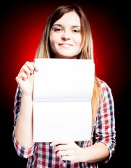 Smiling and proud young girl holding exercise book