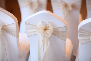 Wedding Seating Decorated with Peach Bows