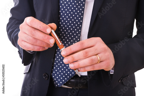 Business man holding a pen.