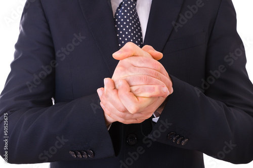Businessman rubbing his hands together.