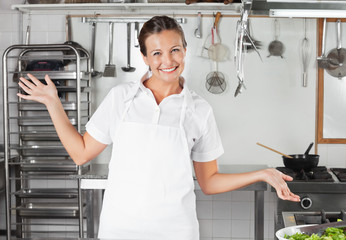 Female Chef Gesturing In Kitchen