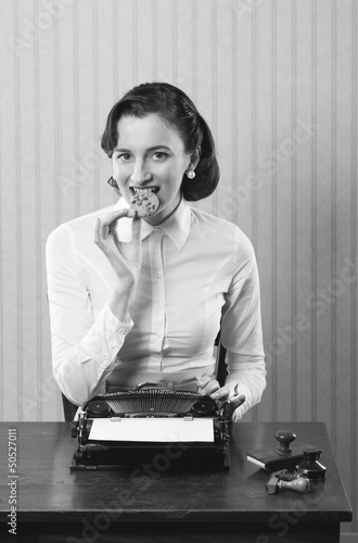 Business woman eating a cookie