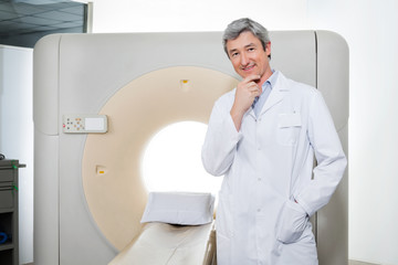 Doctor Standing By Ct Scan Machine
