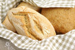 Fresh Italian durum wheat bread in a basket with napkin